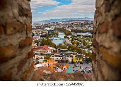 TBILISI, GEORGIA - November 2018: Aerial view of Old Tbilisi from Narikala Fortes. Sunny day in Tbilisi, Georgia