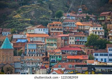 Tbilisi, Georgia - November 2018: Close up of Old Tbilisi houses, church and cable car, Georgia