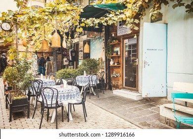 TBILISI, GEORGIA - November 2018: Cozy beautiful outdoor cafe, tables and chairs on the restaurant terrace with Old Tbilisi view on sunny autumn day, Georgia