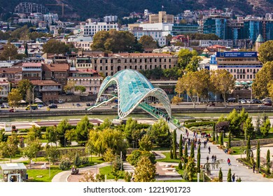 TBILISI, GEORGIA - November 2018: Distant view of the Bridge Of Peace across Kura river In Tbilisi, Georgia