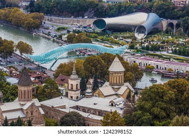 TBILISI, GEORGIA - November 2018: Distant view of the Bridge Of Peace across Kura river in old Tbilisi, Georgia