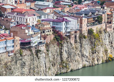 TBILISI, GEORGIA - November 2018: Old houses of Tbilisi on the cliff over Kura river, Old Tbilisi, Georgia