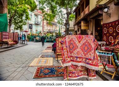 Tbilisi, Georgia - November 2018: Souvenir shop selling traditional carpets in old Tbilisi, Georgia