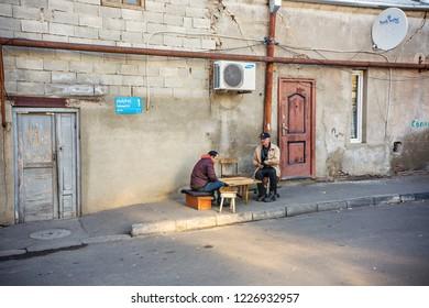 Tbilisi, Georgia - November 2018: Two men playing backgammon on the street in Old Tbilisi, Georgia