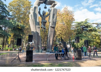 TBILISI, GEORGIA - NOVEMBER 4, 2018: a DJ gets ready by the Deda Ena statue for an open-air wine and cheese festival.