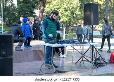 TBILISI, GEORGIA - NOVEMBER 4, 2018: a DJ gets ready at an outdoor wine and cheese festival in the city centre.
