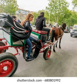 TBILISI, GEORGIA, October 15, 2016: People in the carriage with horses on a city street