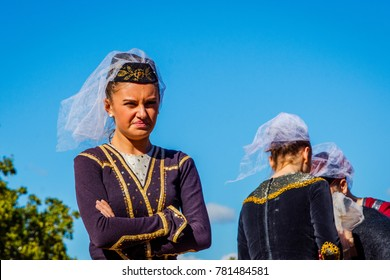 TBILISI, GEORGIA - OCTOBER 15: Portrait of a woman dressed in a traditional Georgian dress at the festival. October 2016