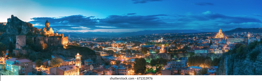Tbilisi, Georgia. Panorama Of Narikala Fortress, Bridge Of Peace, Music Hall, Metekhi Church, Presidential Administration Palace, Sameba Holy Trinity Cathedral In Evening Night Illumination