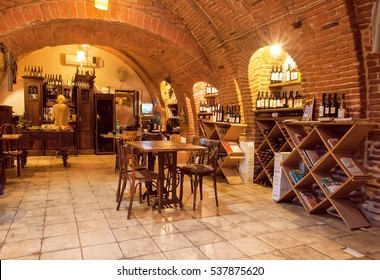 TBILISI, GEORGIA - SEP 26: Empty wine bar inside the old brick underground with restaurant furniture and wine bottles on September 26, 2016. Tbilisi has population of 1.5 million people