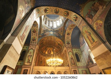 TBILISI, GEORGIA, SEPTEMBER 19, 2017. Murals and frescos decorate the Interior of Sioni Cathedral (Georgian Orthodox) as rays of sunlight enter through a side window.