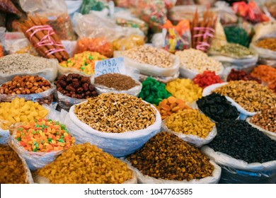 Tbilisi, Georgia. View Of Persian English Common Walnut (Juglans Regia), Succade And Dried Fruits In Bags On Showcase Of Local Food Market.