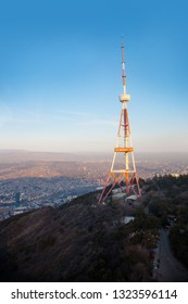 Tbilisi Historic Old Town TV tower View Geargia capital with mountains and evening sunset light