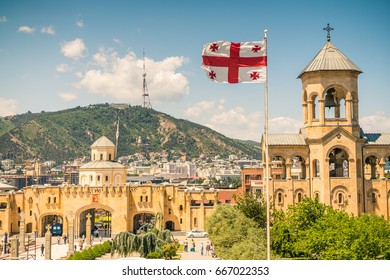 Tbilisi skyline with Georgian flag