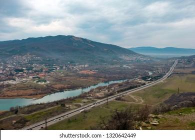 Tbilisi-Senaki-Leselidze E60 Highway by the Aragvi river in Mtskheta, Georgia - AERIAL