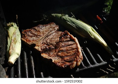 T-Bone Steak and Corn on the Cob on an Outdoor Grill