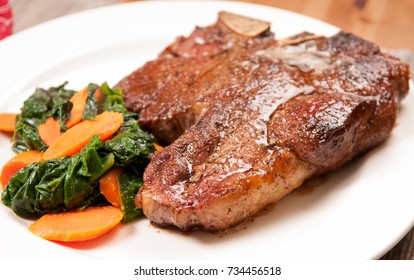 t-bone steak with spinach and carrot, a ketogenic diet meal