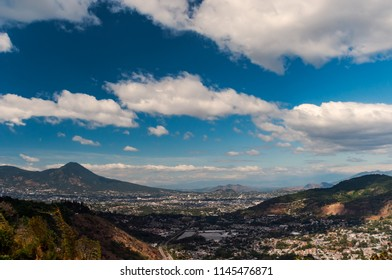 Te city of San Salvador in El Salvador viewed from afar depicting the valley in which it lies.