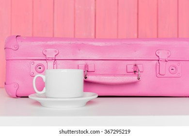 Tea accessories on pastel wooden background