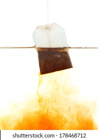 Tea bag dipped in hot water