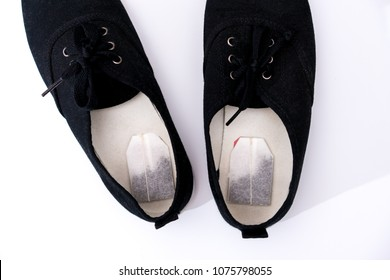 Tea bag inside the shoes. concept of removing unpleasant odors