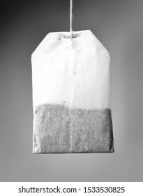 Tea bag on gray background