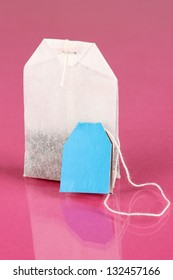 Tea bag on pink background