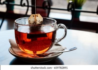 Tea bag put in transparent glass teacup