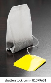 tea bag with yellow label on black background