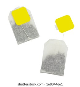 Tea bag with yellow label without inscription. Isolated on white background