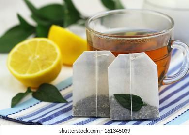 Tea bags, tea and fresh lemon