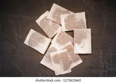 tea bags on a concrete background, a place for advertising and inscriptions, copy space