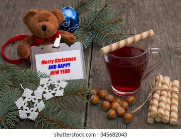 tea, baking, nutlets and a toy bear with a label, the subject Christmas and New Year