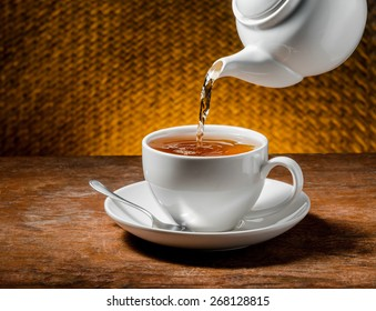 Tea being poured into tea cup