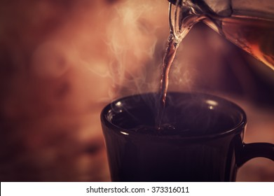 Tea being poured into tea cup.Vintage effect