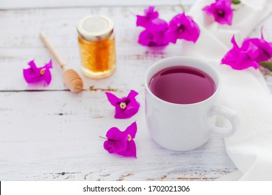 tea of Bougainvillea flowers or te bugambilia with honey and raw flowers and leaves