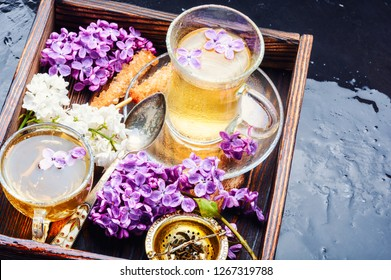 Tea and bouquet of beautiful spring flowers.Flower tea