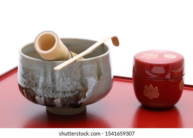Tea bowl with tea whisk and bamboo spoon used in Japanese matcha green tea ceremony