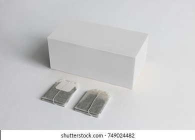 Tea Box and tea bag with Label Mockup. White objects. Paper box template isolated on white background. Package white box on a white background