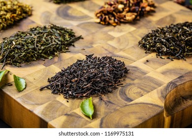 tea can of freshly brewed black tea,warm soft light, darker background.
