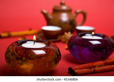 tea candles with cups and pot