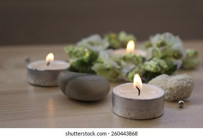 Tea candles on wood