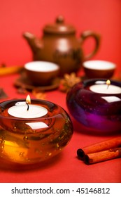 tea candles with two cups and pot