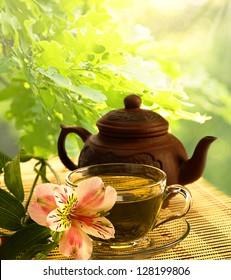 tea ceremony. Green tea, flower and teapot