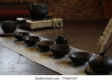 Tea ceremony at yoga palace house of harmonious development black china traditions cups Tie Guan Yinn