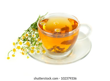 Tea with chamomile on white background