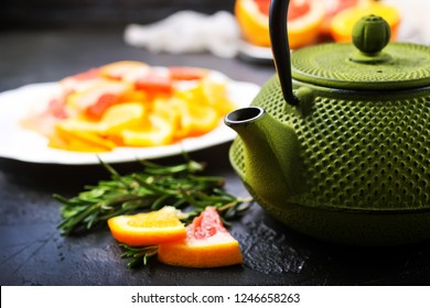 Tea with citrus in teapot, teapot with tes