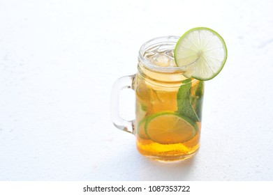 Tea cocktail with lemon and ice.