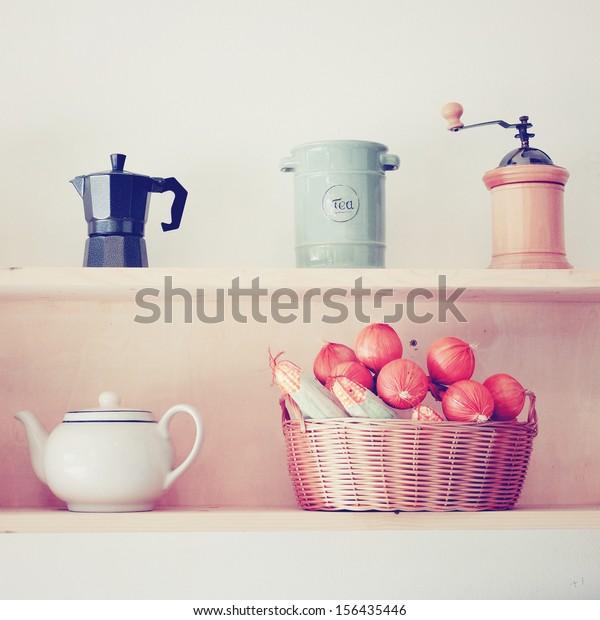 Tea and coffee equipment in kitchen, nostalgic still life, retro filter effect