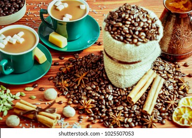 Tea or coffee - hot drink on the table with sweets and spices